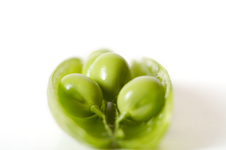 Close up of green peas in pod on white background. Shallow DOF. Stock Photo - 1528234