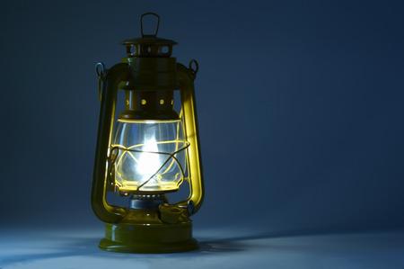 hurricane lamp: Old oil lantern in darkness. Light concept.
