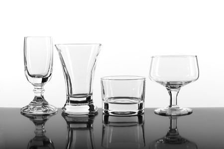 Different type of glasses in a row against white background. Stock Photo - 1830440