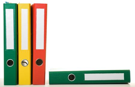 Colorful old binders against white background. Office life.