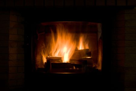 Close up of blazing fireplace with few logs. Stock Photo - 2025183