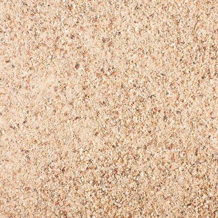 sand grains: Sand texture tile as abstract background. Sand pattern.