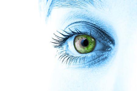 Green eye and blue tone face close-up. Shallow DOF. Stock Photo
