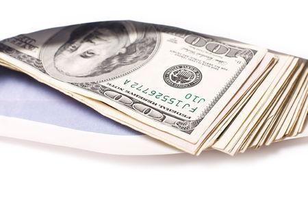 Dollars in envelope against white background. Shallow DOF. photo