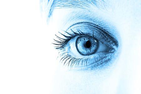 Eye and blue tone face close-up. Shallow DOF. Stock Photo
