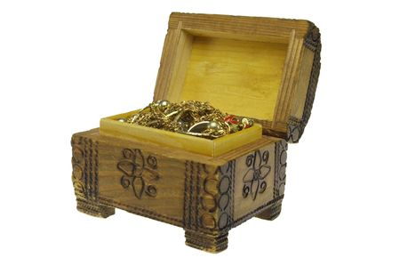 filled: treasure chest filled with gold. Isolated on white background Stock Photo