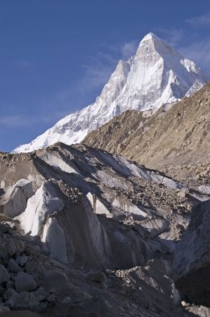 shivling: View to Shivling mountain (6540m high) and edge of Gomukh glacier, where from Bhagirathi river begins and later becomes Ganga. Picture has been taken early in the morning. Stock Photo
