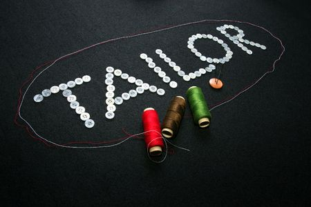accesories: a letter tailor was created by buttons and other accesories