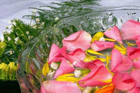 destress: fresh pink rose petal and natural pebbles on the flower background. Suitable for spa and relaxation setting.