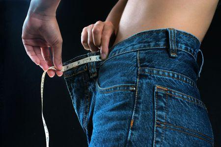 vientre femenino: Femenino vientre con cinta m�trica  Foto de archivo