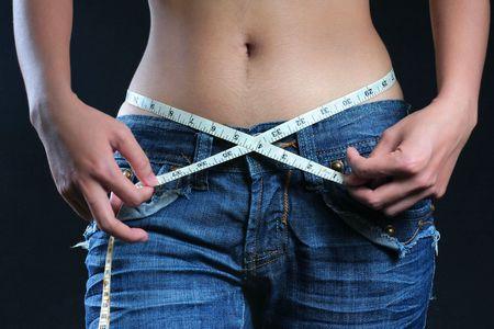 abdomen female: Sexy foto de mujeres vientre con cinta m�trica
