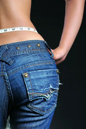 sexy shot of female belly with tape measure Stock Photo - 806772