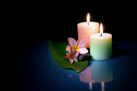 unwind: Frangipane flower with pebble and candle