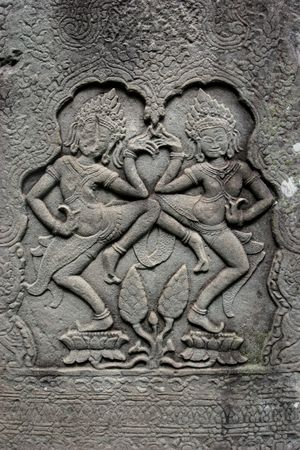 embed: apsara dancers embed on the wall in angkor temple
