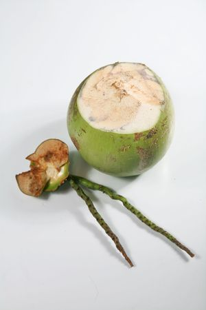 Green coconut with straw on isolated background. photo
