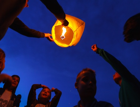 galati: Children are seen launching a paper lantern during the manifestations on the International Childrens Day, in Galati, Romania, June 1, 2013.