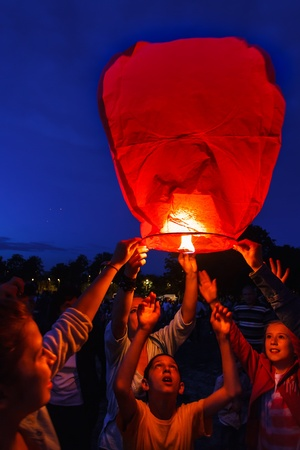 manifestations: Children are seen launching a paper lantern during the manifestations on the International Childrens Day, in Galati, Romania, June 1, 2013.