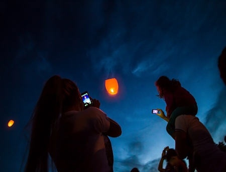 manifestations: Children shoot with mobiles the paper lanterns during the manifestations on the International Childrens Day, in Galati, Romania, June 1, 2013.