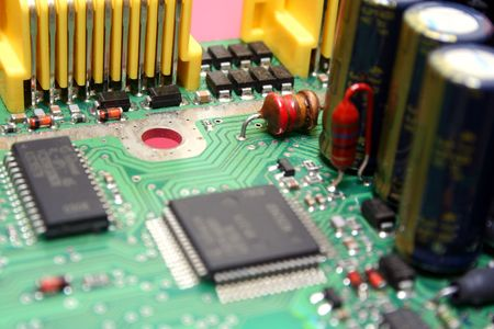 Printed circuit board with various electronics components assembled on it.