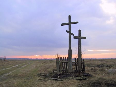 catolic: Eastern orthodox church and catolic church crosses standing togather near road
