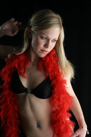 The beautiful blonde with a red boa Stock Photo - 534113