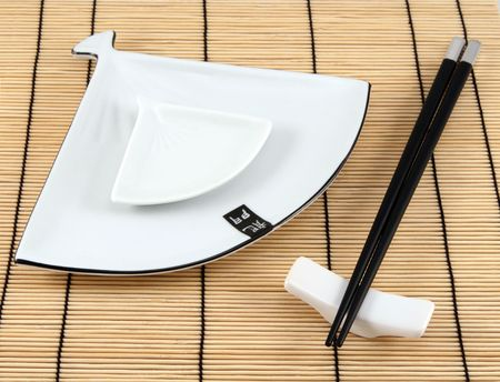 sushi plate: Sushi plate and chopsticks on bamboo mat Stock Photo