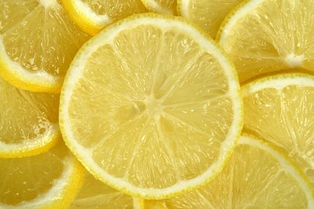 lemony: Lemon cut by slices,background,close-up Stock Photo