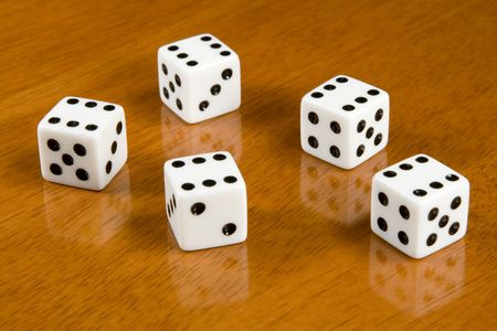five dices on a table photo