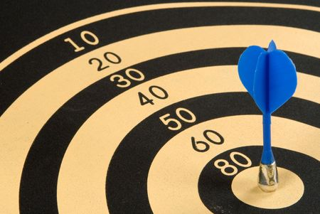 magnetic: Magnetic dart in a target Stock Photo