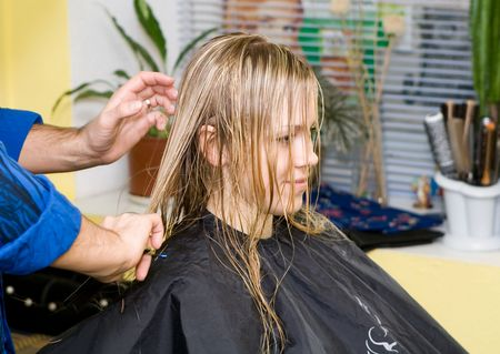 Barber makes a hair-dress to the young blonde Stock Photo - 643984