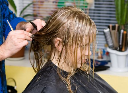 Barber makes a hair-dress to the young blonde Stock Photo - 643985