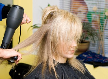 Barber makes a hair-dress to the young blonde Stock Photo - 643976