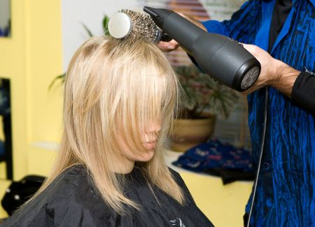 Barber makes a hair-dress to the young blonde Stock Photo - 643977