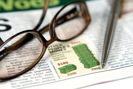 Glasses and pen on a newspaper Stock Photo - 658814