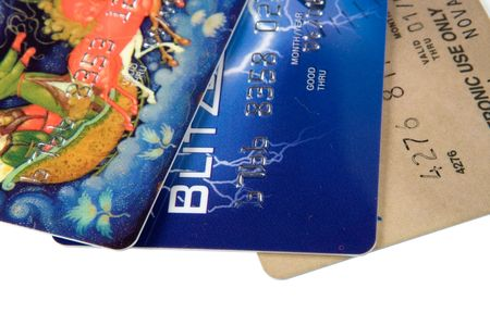 creditcards: Three credit cards, isolated on white, close up