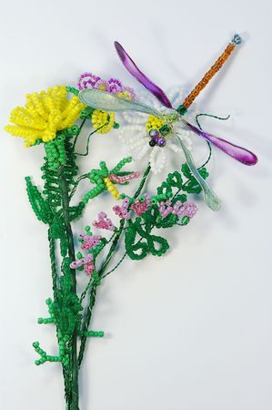 Bead composition with flowers and the dragonfly Stock Photo