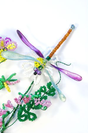 Bead Komposition mit Blumen und Dragonfly, isolated on the white Background... Lizenzfreie Bilder
