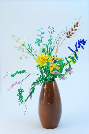 Bouquet of bead flowers in earthenware vase