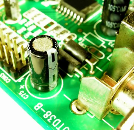 jacks: Electronic Elements. Only the electrolytic capacitor is on focus to represent one type of electronic elements. Stock Photo
