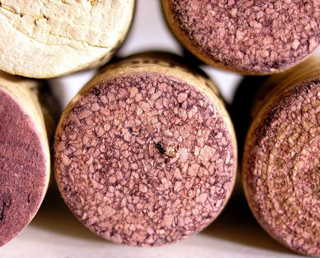 specific: The beauty of Merlot. The red wine made from grape Merlot has a specific dark red color - for comparison is shown a cork from other type wine.