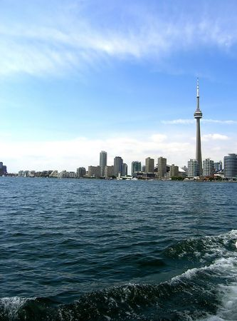 Toronto Sky Line. Toronto skyline. The group of buildings placed where the sky is meeting the water.
