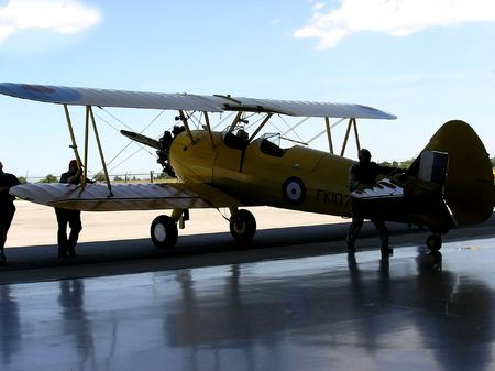 Back in hangar. Boeing Stearman PT27 Kadet is returning in his airshed. Stock Photo