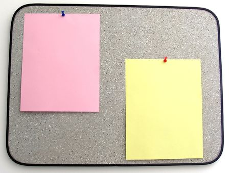 bulletinboard: Grey cork bulletinboard hanged on white painted wall with one yellow and a pink sheets ready to be filled by the designer with announcement.