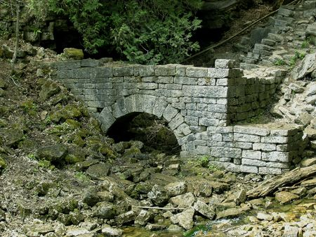 Ruins of the past. The fundament of water mill built from the first settlers in area of Sixteen Mile Creek around Niagara Escarpment in Ontario in 1835.
