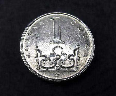 koruna: Close up picture of head side of One Czech Koruna coin over black background.