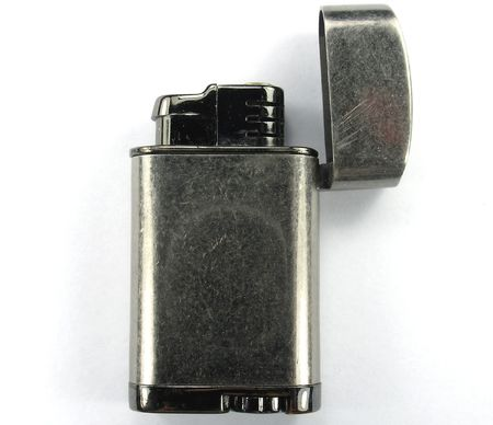 gas lighter: Cigarette and Cigar Gas Lighter with crystal ignition over white background.