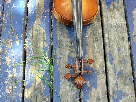 violins: Violin over the blue painted porch.