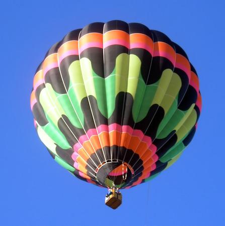 Hot air balloon floating in the air. London Balloon Festival August 2007.