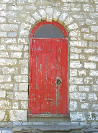 The door. Painted in red door to the navigation light of a lighthouse. photo