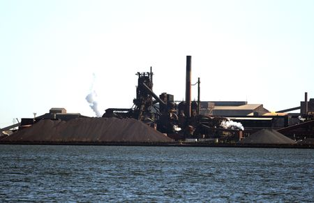 tertiary: Factory on the shore. Big factory built mostly over the tertiary taken from the lake.